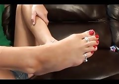 Cute gf performs footjob to her partner