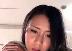 Ren Azumi enjoys an oriental fake penis on her clit