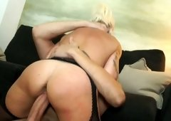 Raunchy trollop with plumpish fake tits fucks her client reverse cowgirl style