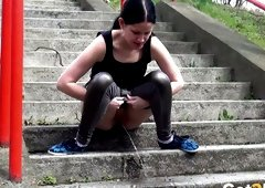 Raven haired immodest sweetie finds pissing on stairs very captivating